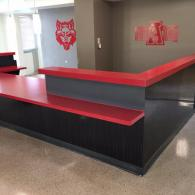 This is a reception desk at Kays hall at Arkansas State University. It was resurfaced with a Scarlett red with a Stonewall gray Multi-Stone.