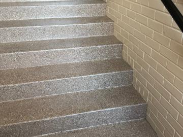 This set of stairs had peeling paint on that we removed all of the paint off the floor and stairs and resurfaced the stairs and floors.