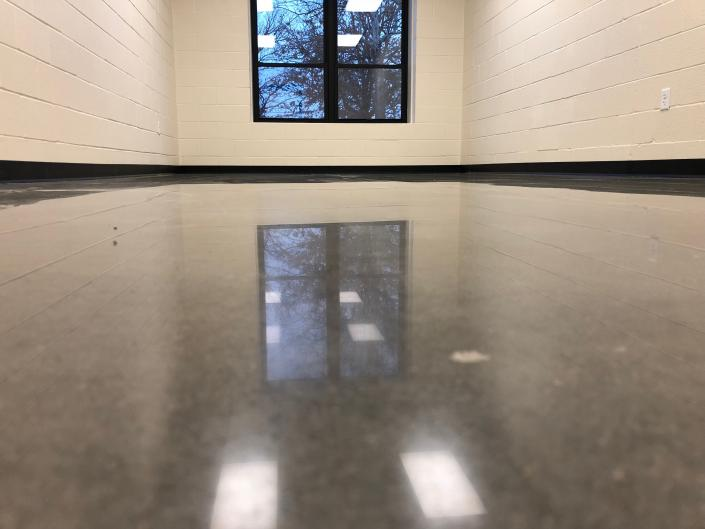 This school wanted this flooring to be low maintenance, which is why we offered polished concrete.